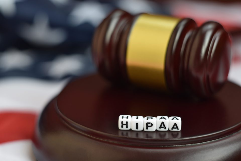 How can email redaction be used to help hospitals meet HIPAA compliance?